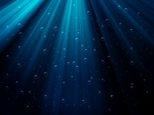 underwater scene with bubbles and sunrays